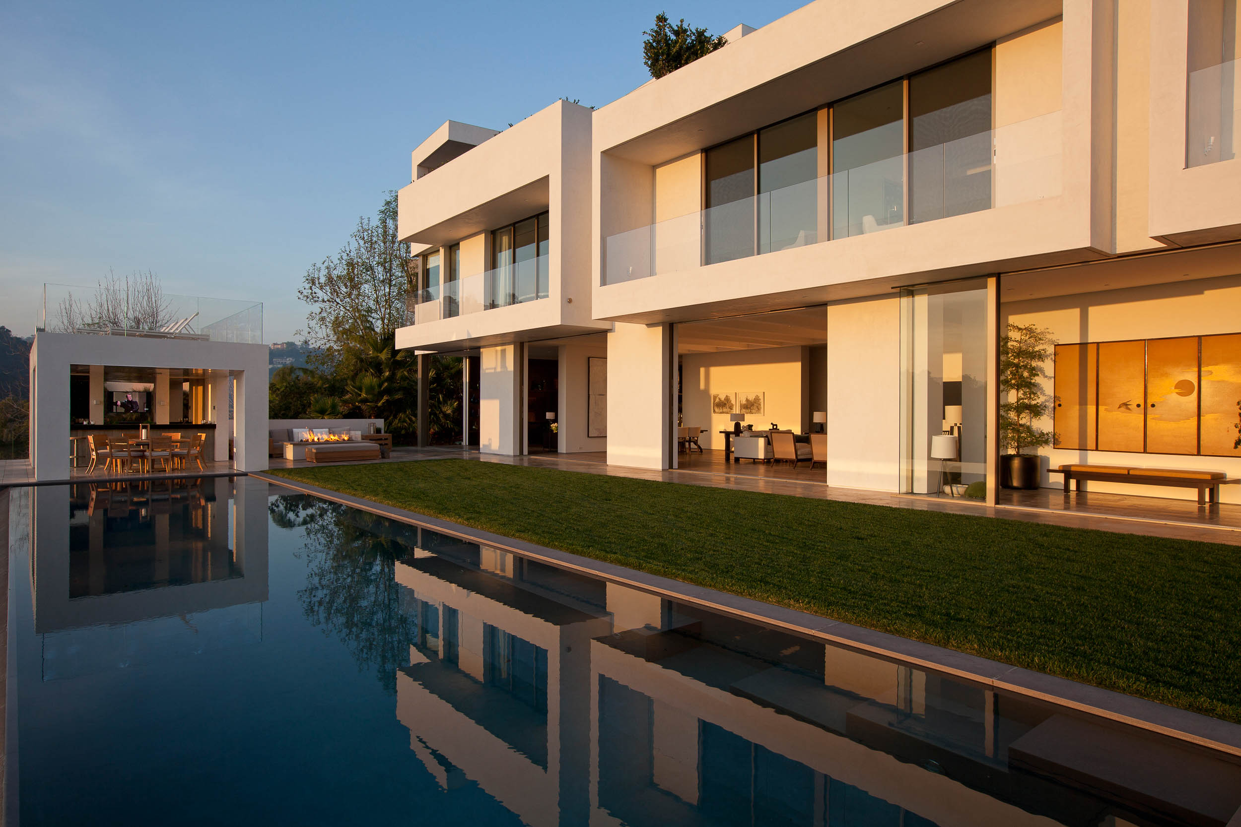 modern house with open dining room overlooking pool