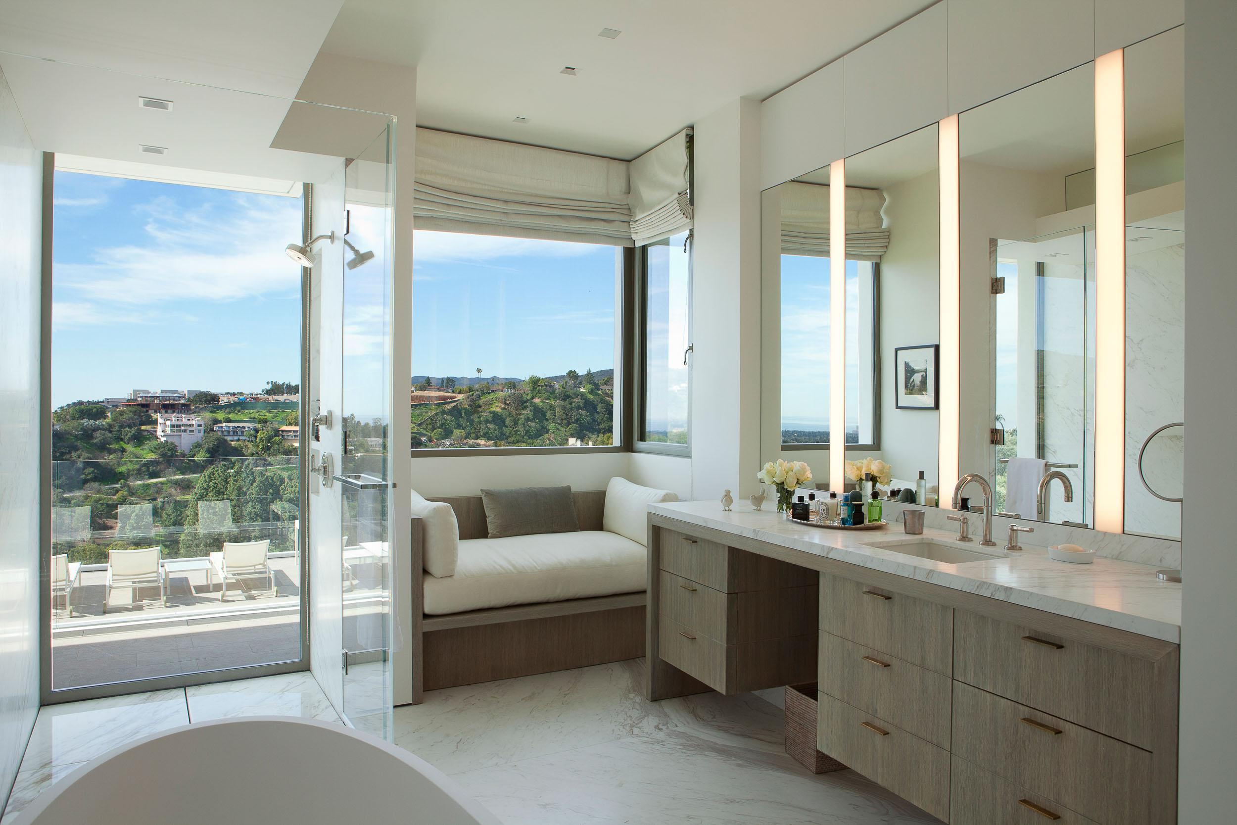 master bathroom overlooking lounge chairs