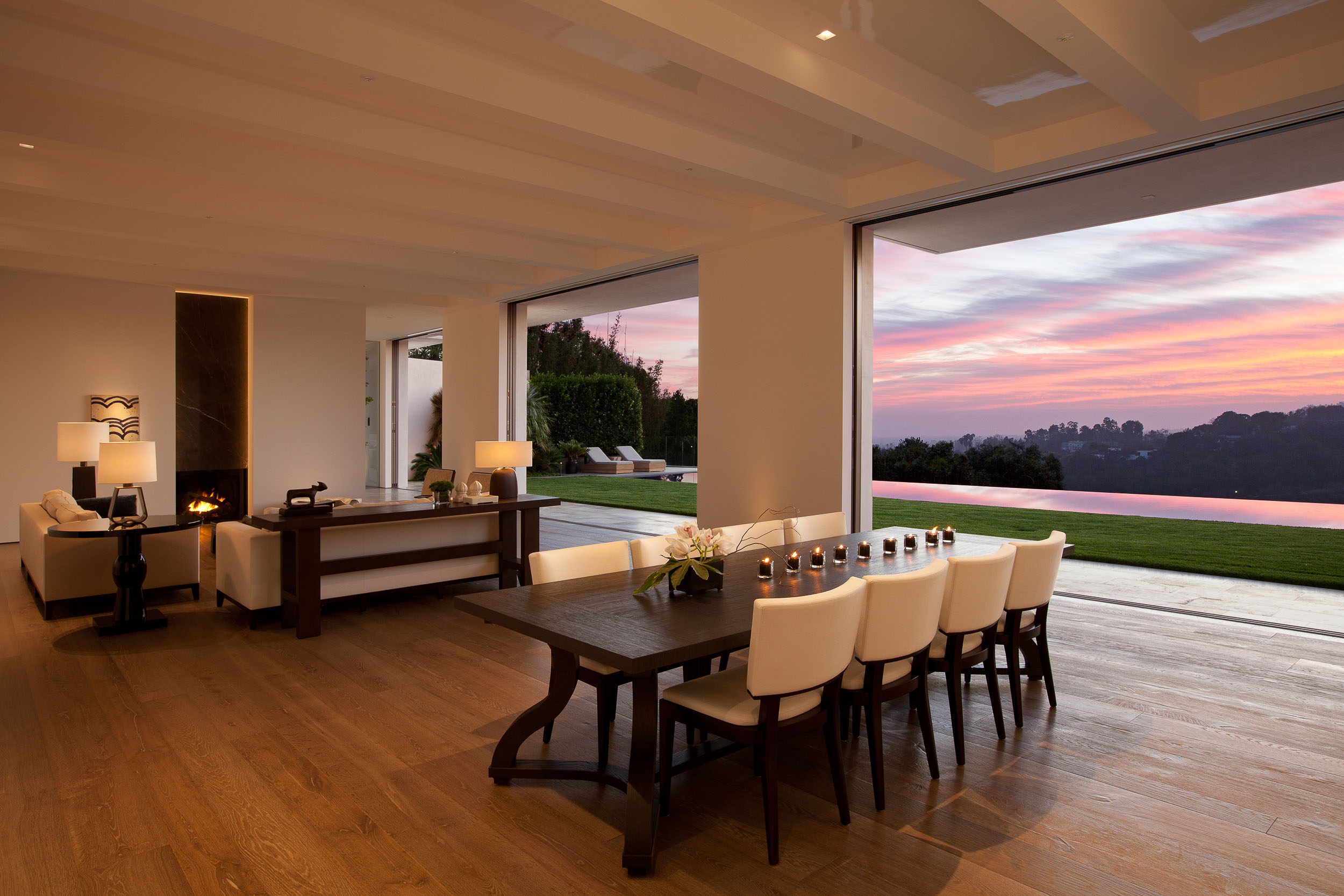 living room with open walls overlooking sunset