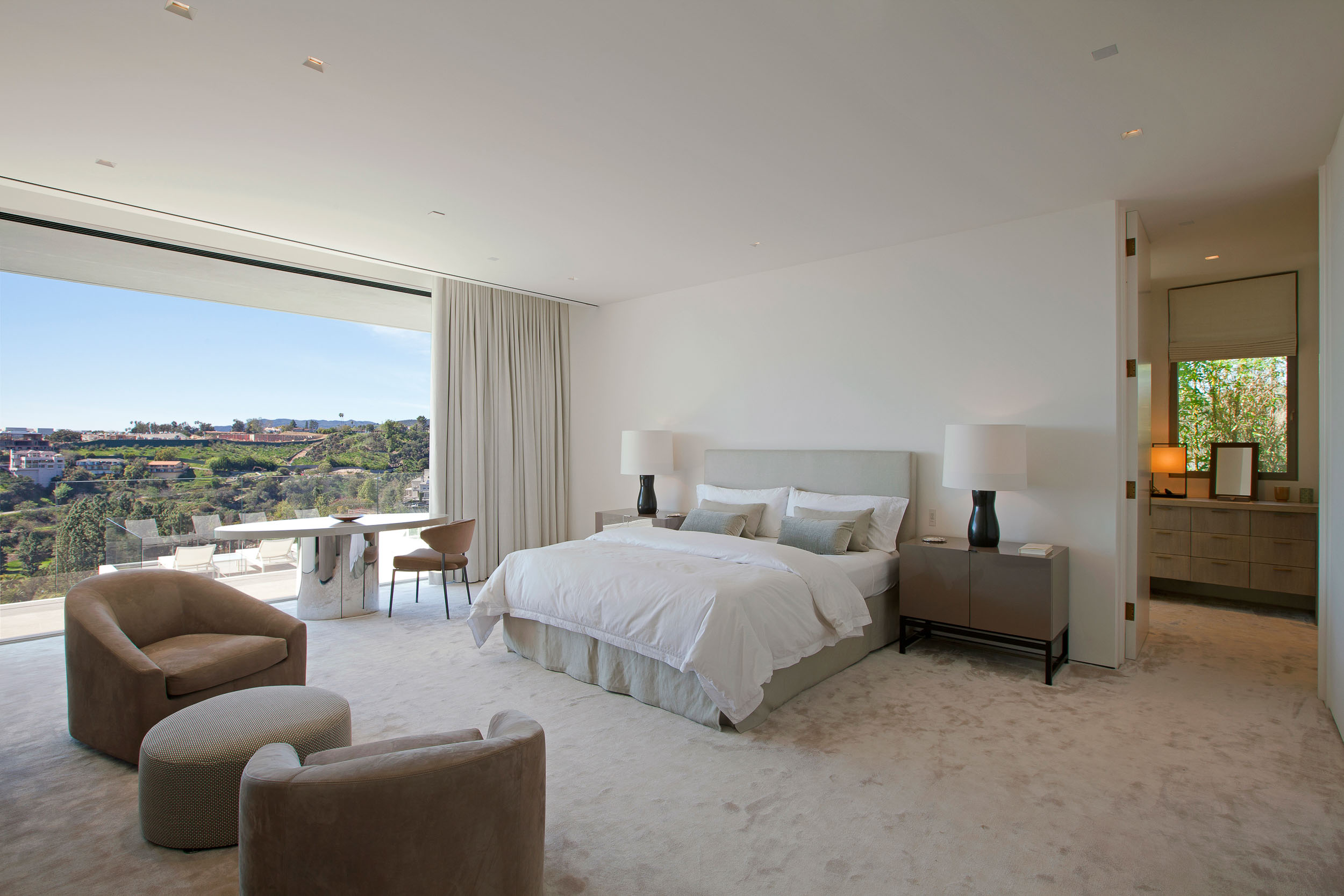 neutral master bedroom with large window