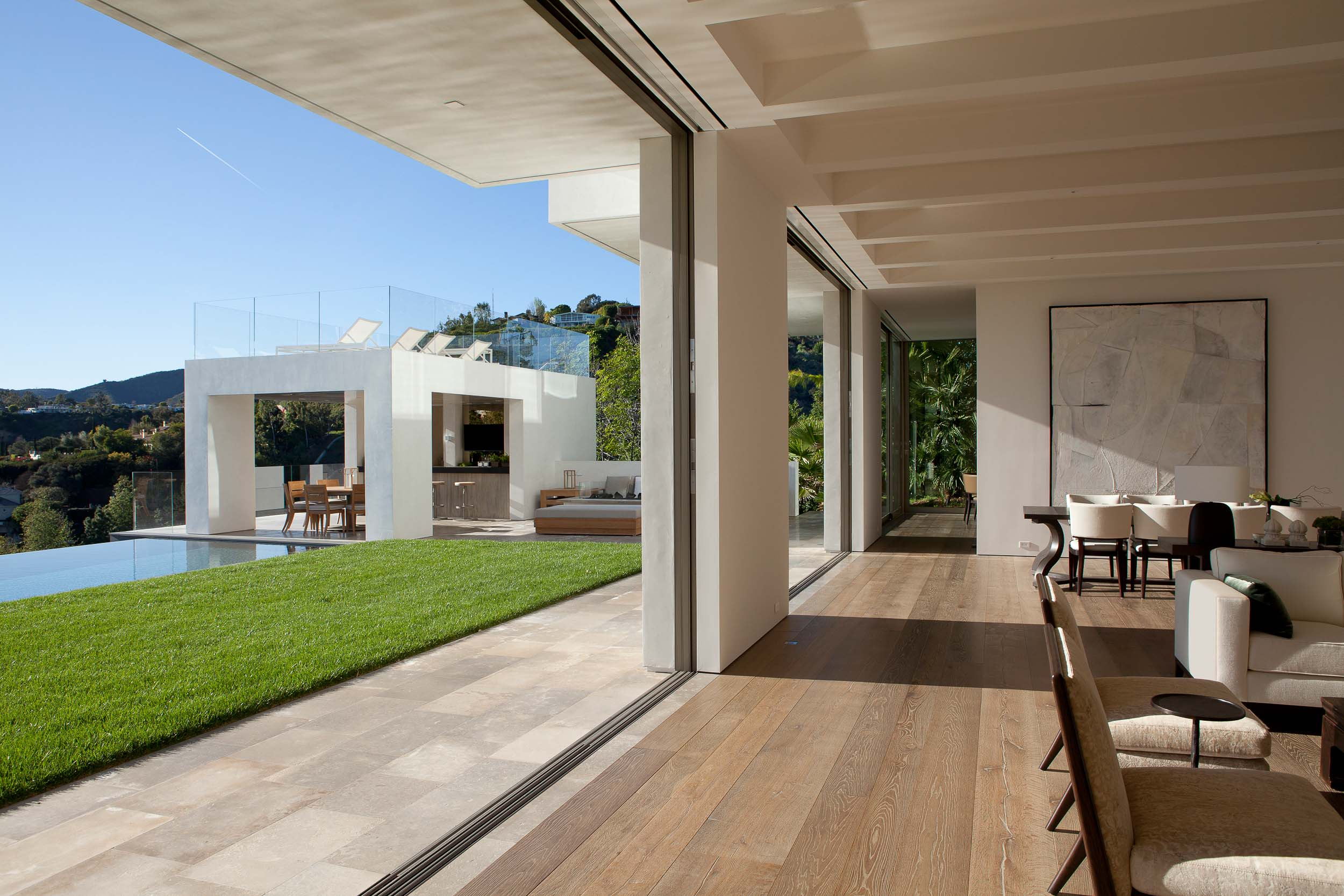 modern interior opens onto backyard and infinity pool