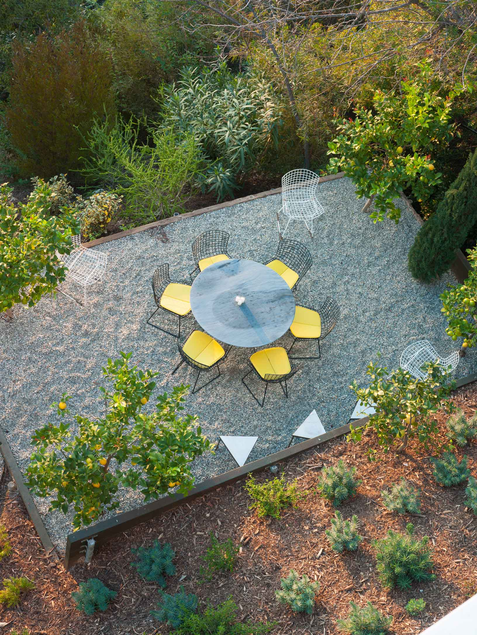 aerial view of circular table outdoors with yellow chairs
