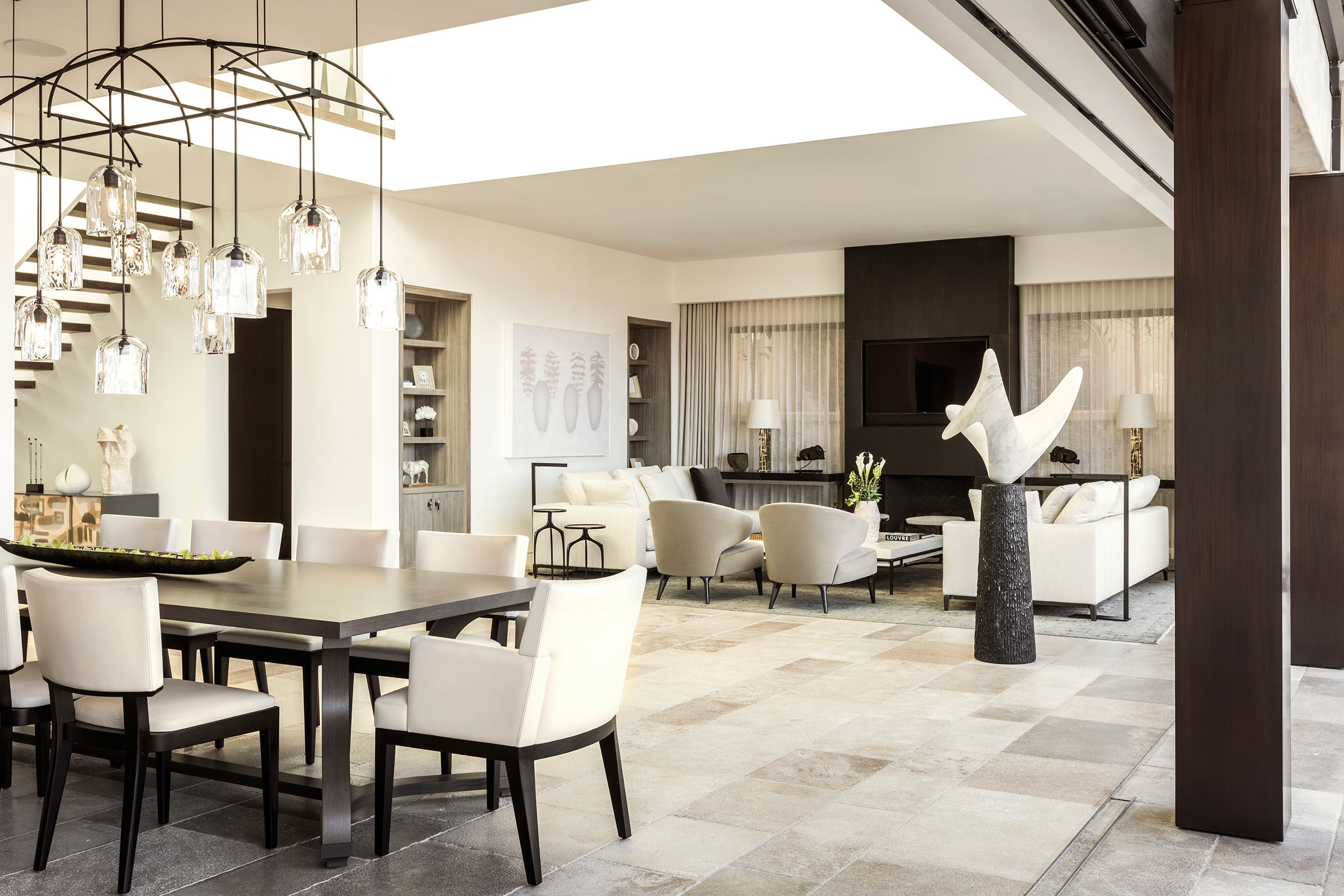Muted neutral colors in the interior blend the rooms into a cohesive experience