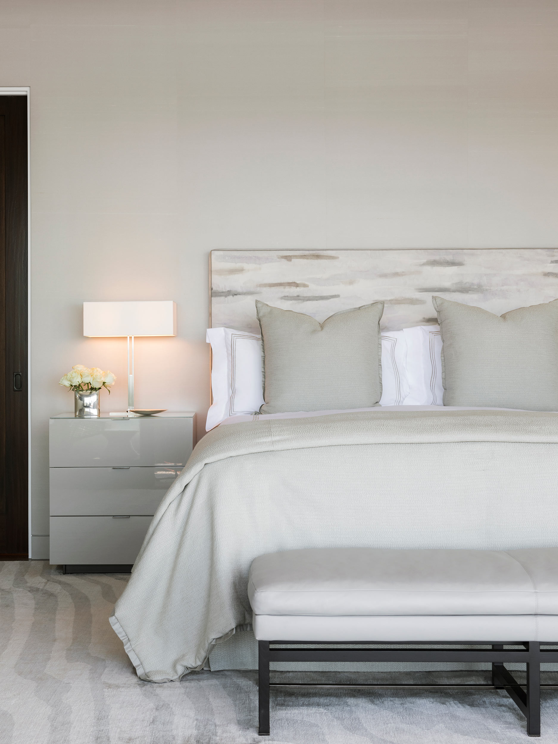 a peaceful and serene bedroom lets the ocean be the focal point