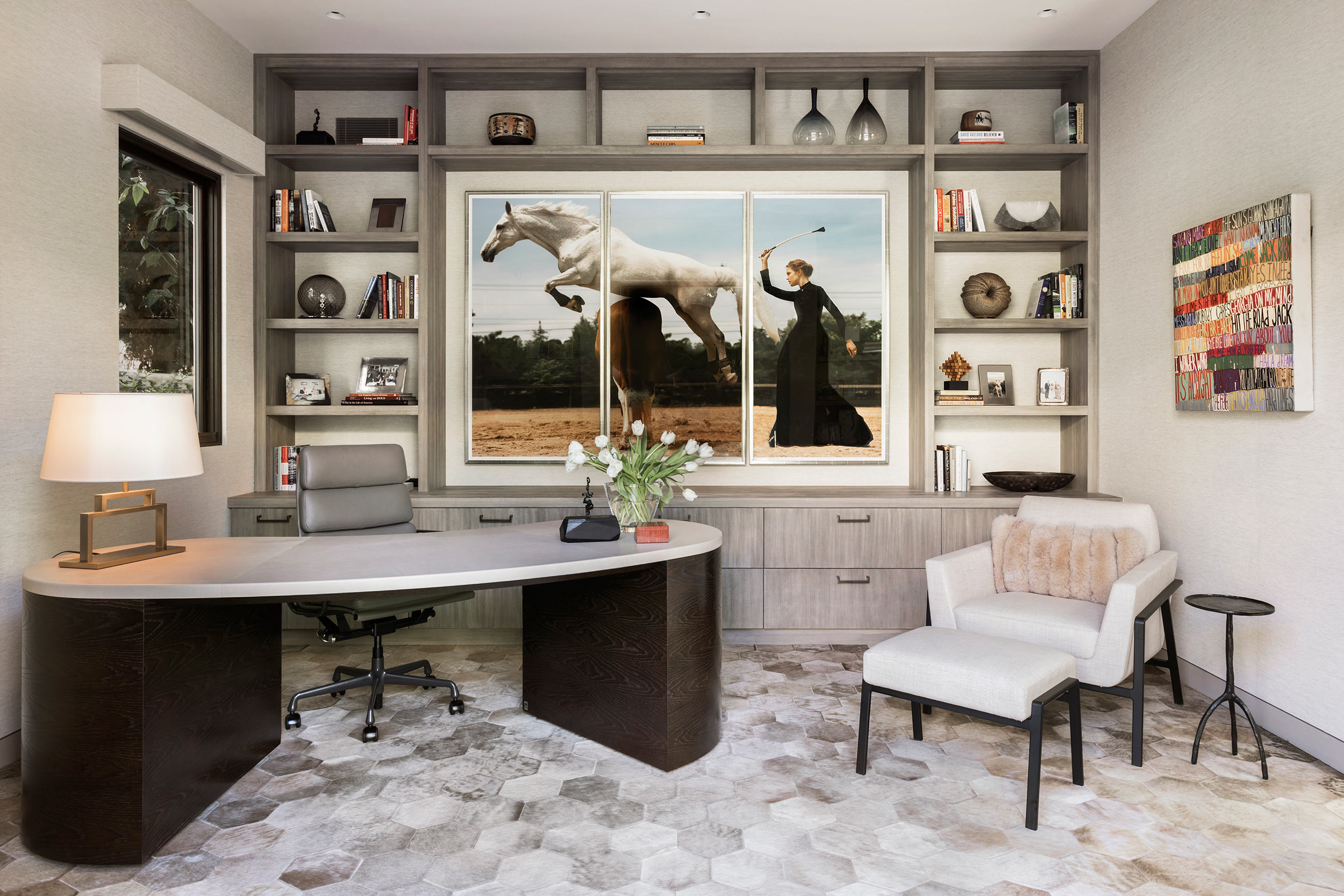 Residential office with art and custom millwork