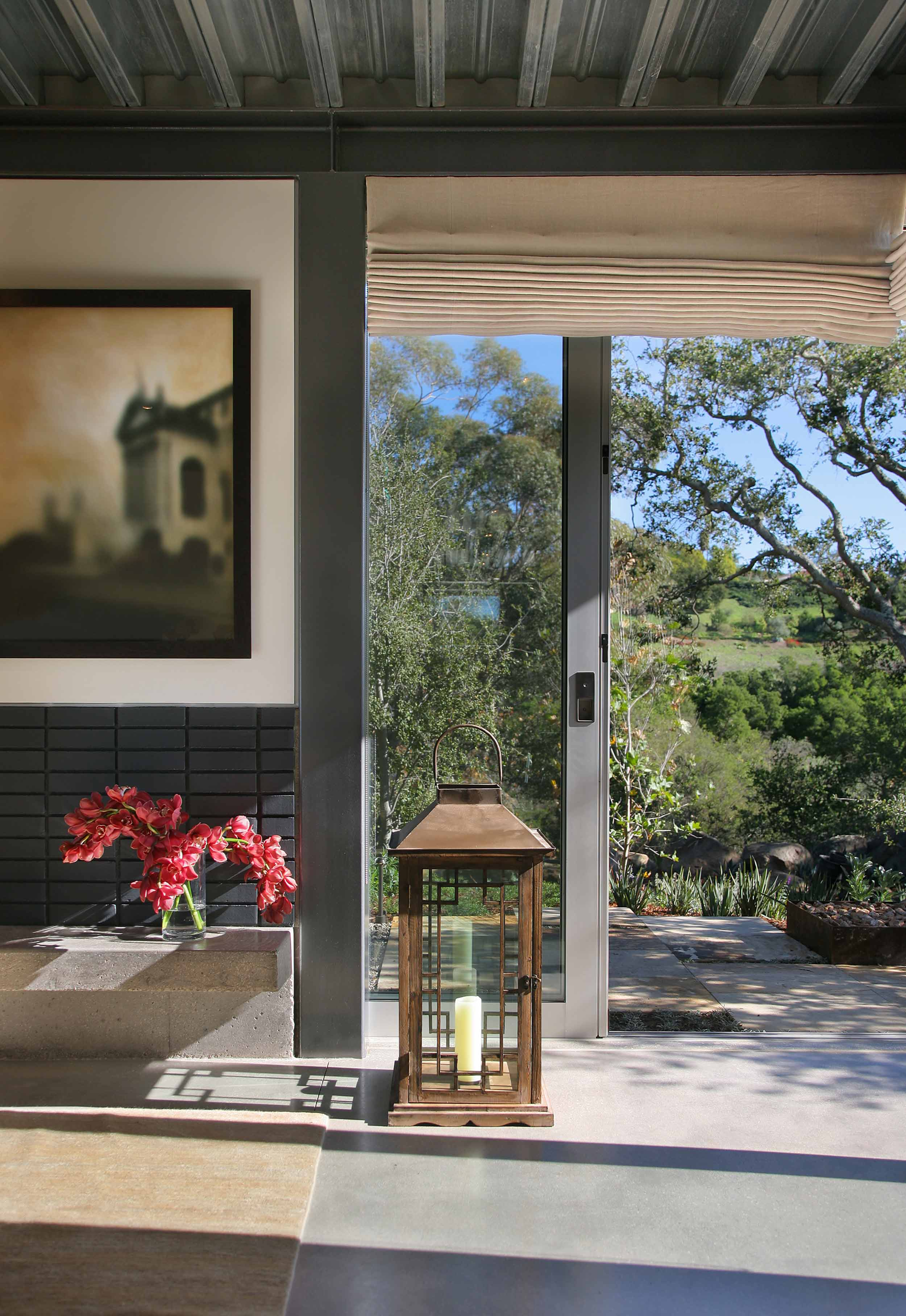 large lantern and artwork by entryway