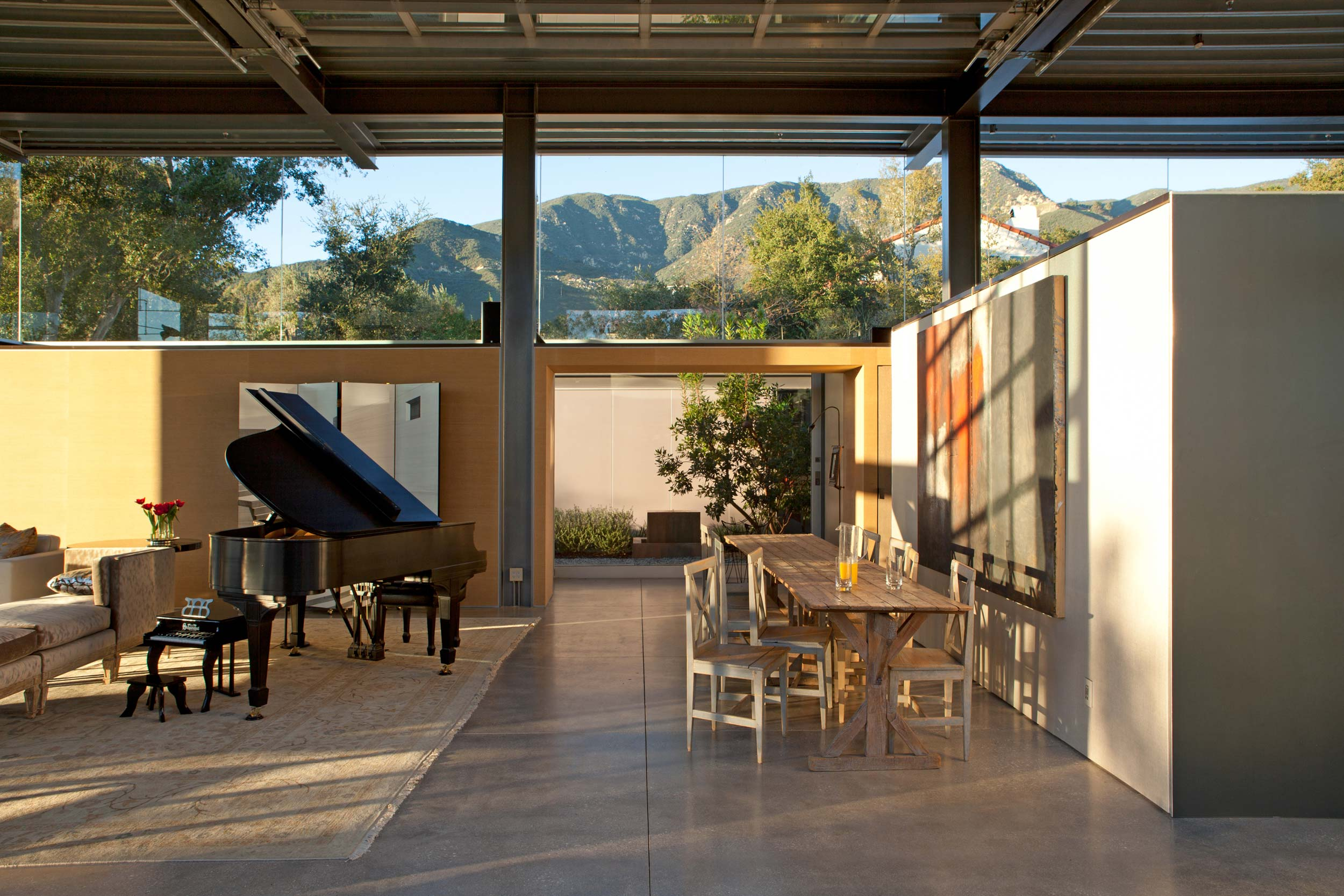 open interior with piano and mountain view