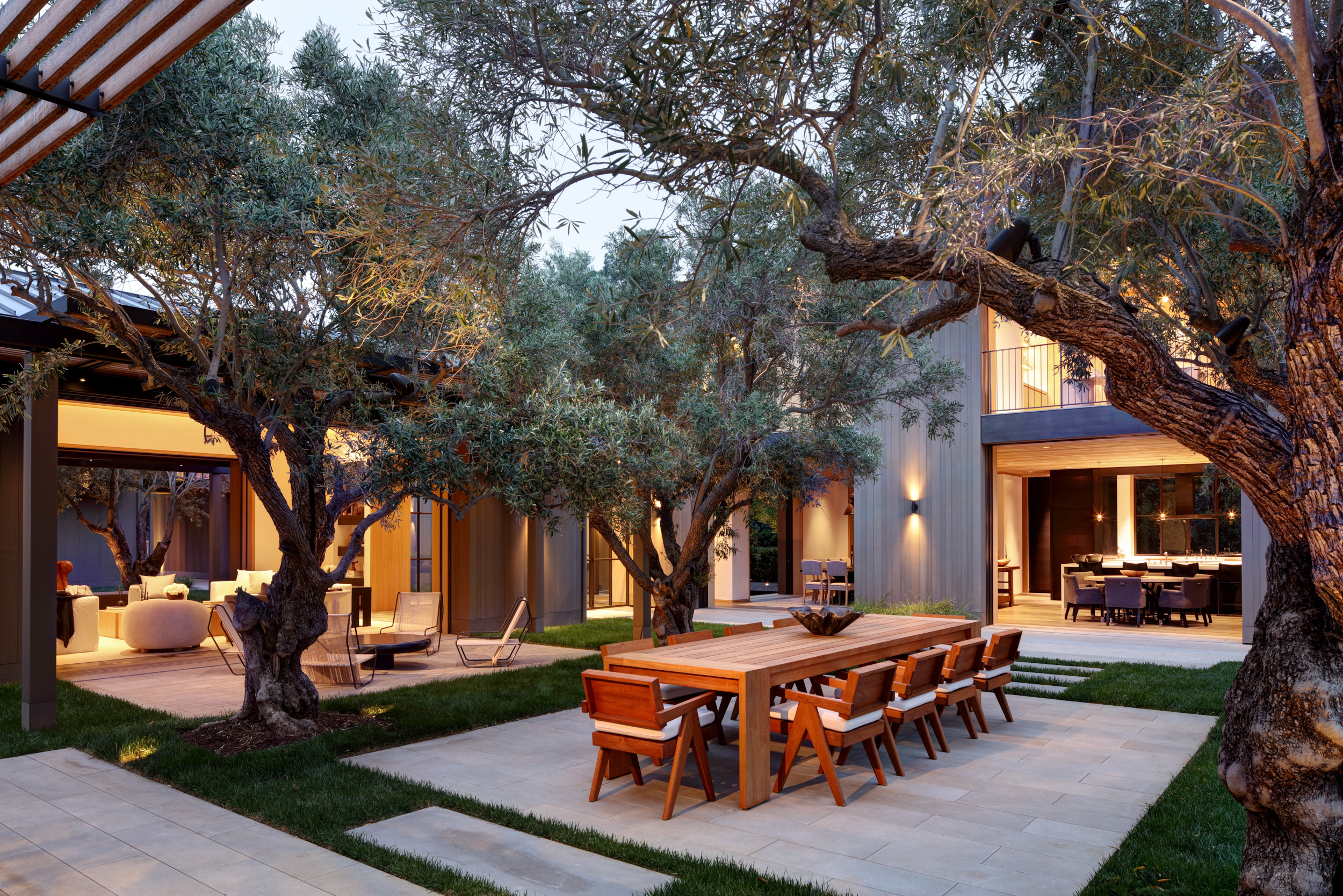 modern residential courtyard with pavers and olive trees