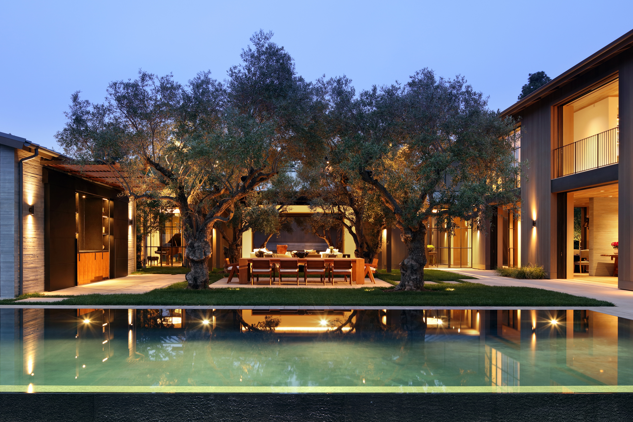 infinity pool in courtyard with olive trees