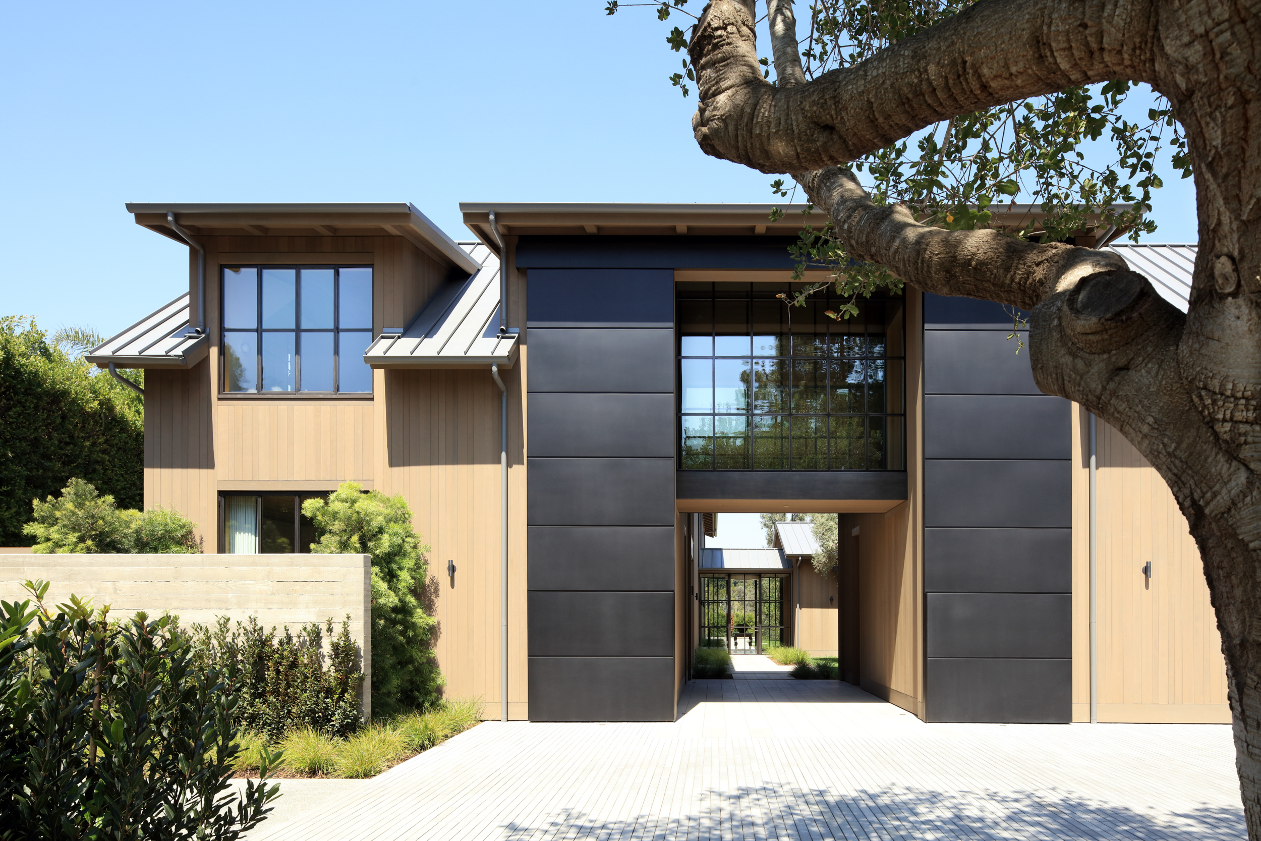 modern home entrance looking through to courtyard