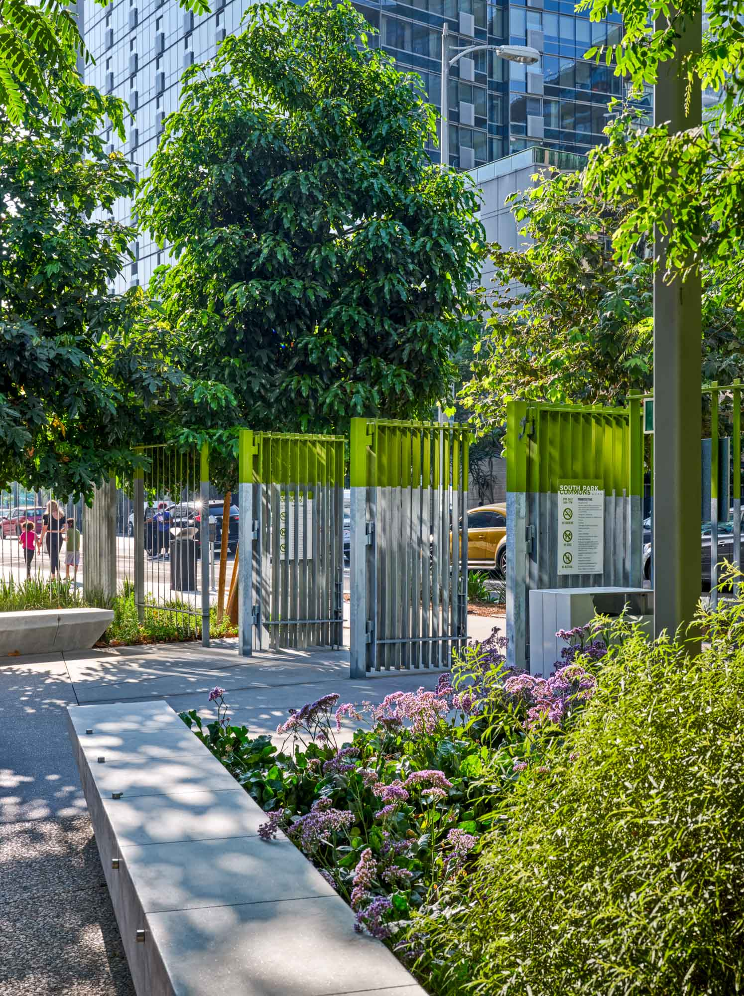 gates to south park commons surrounded by bushes and trees