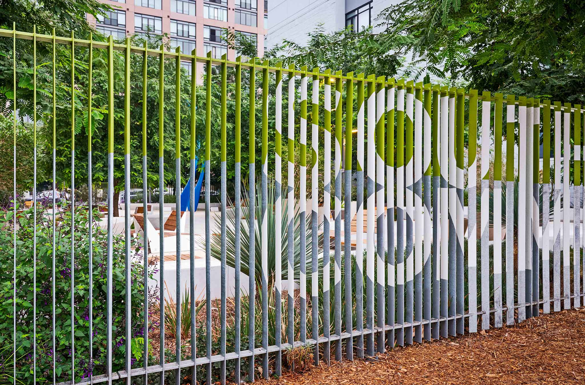 """fence with """"south park commons"""" painted on the side"""
