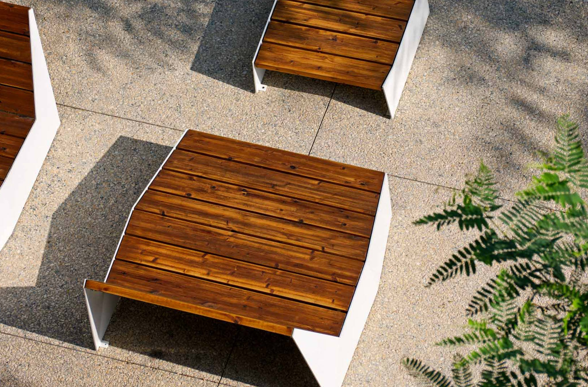 aerial close up of wooden furniture with white detailing