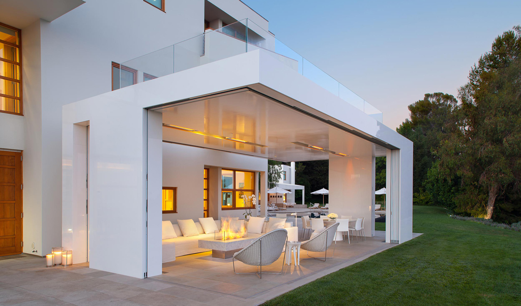 Home in the evening with sliding doors that open up to the outside