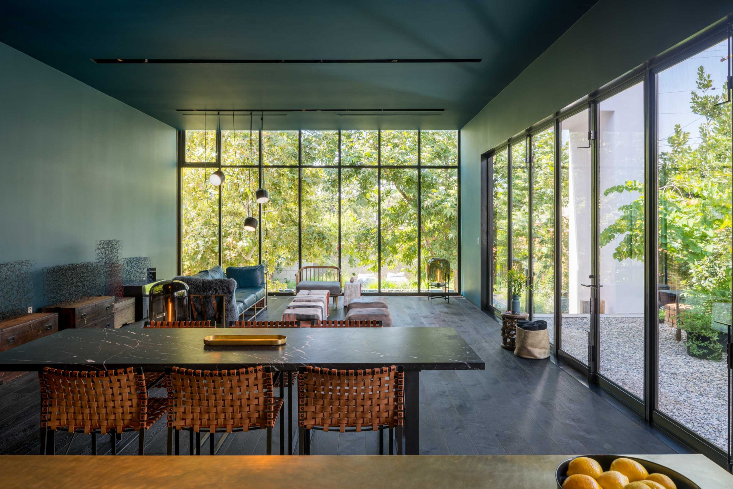 modern bungalow living room with kitchen table and large window