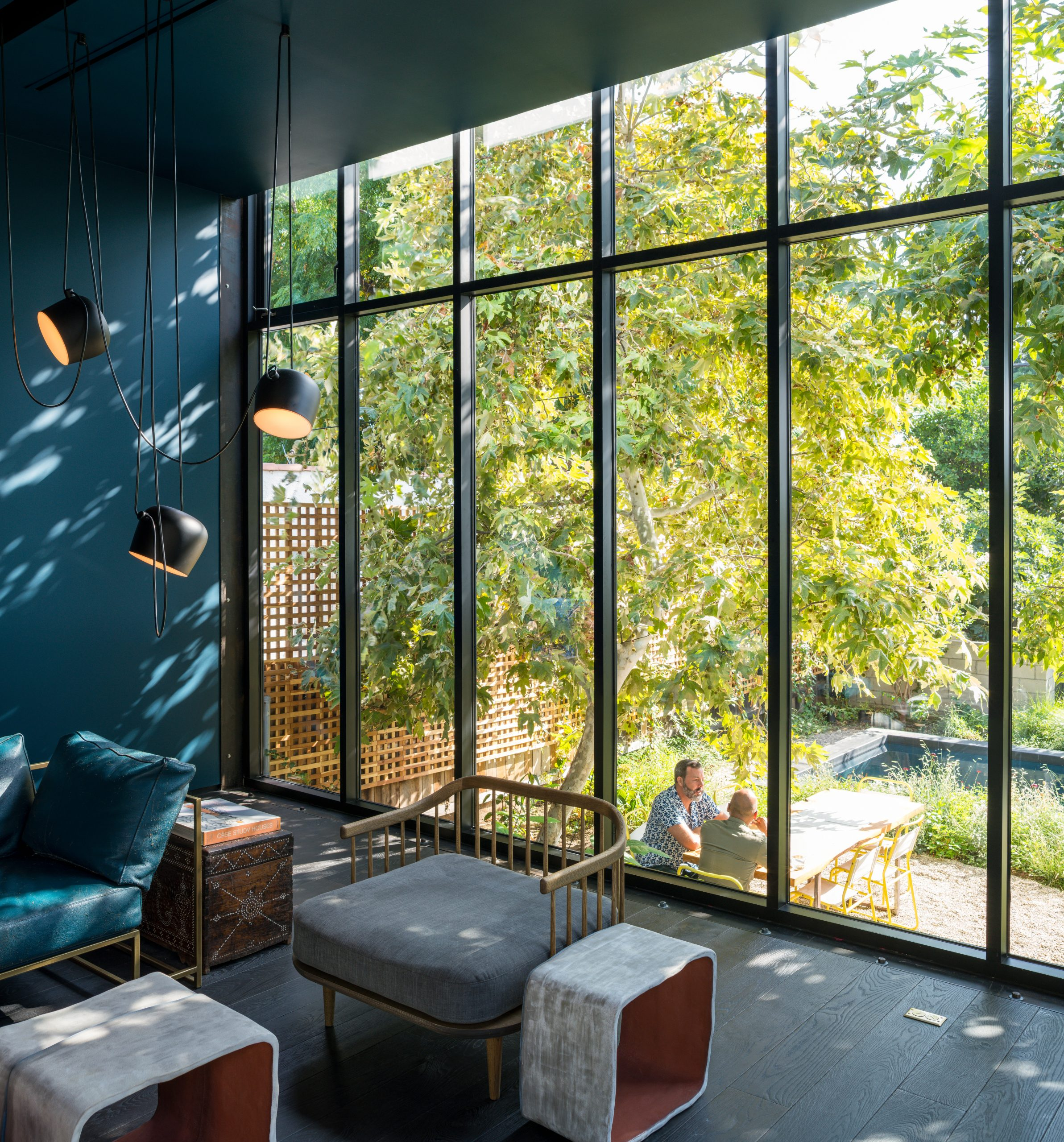 blue wall with view to outdoor tree and table