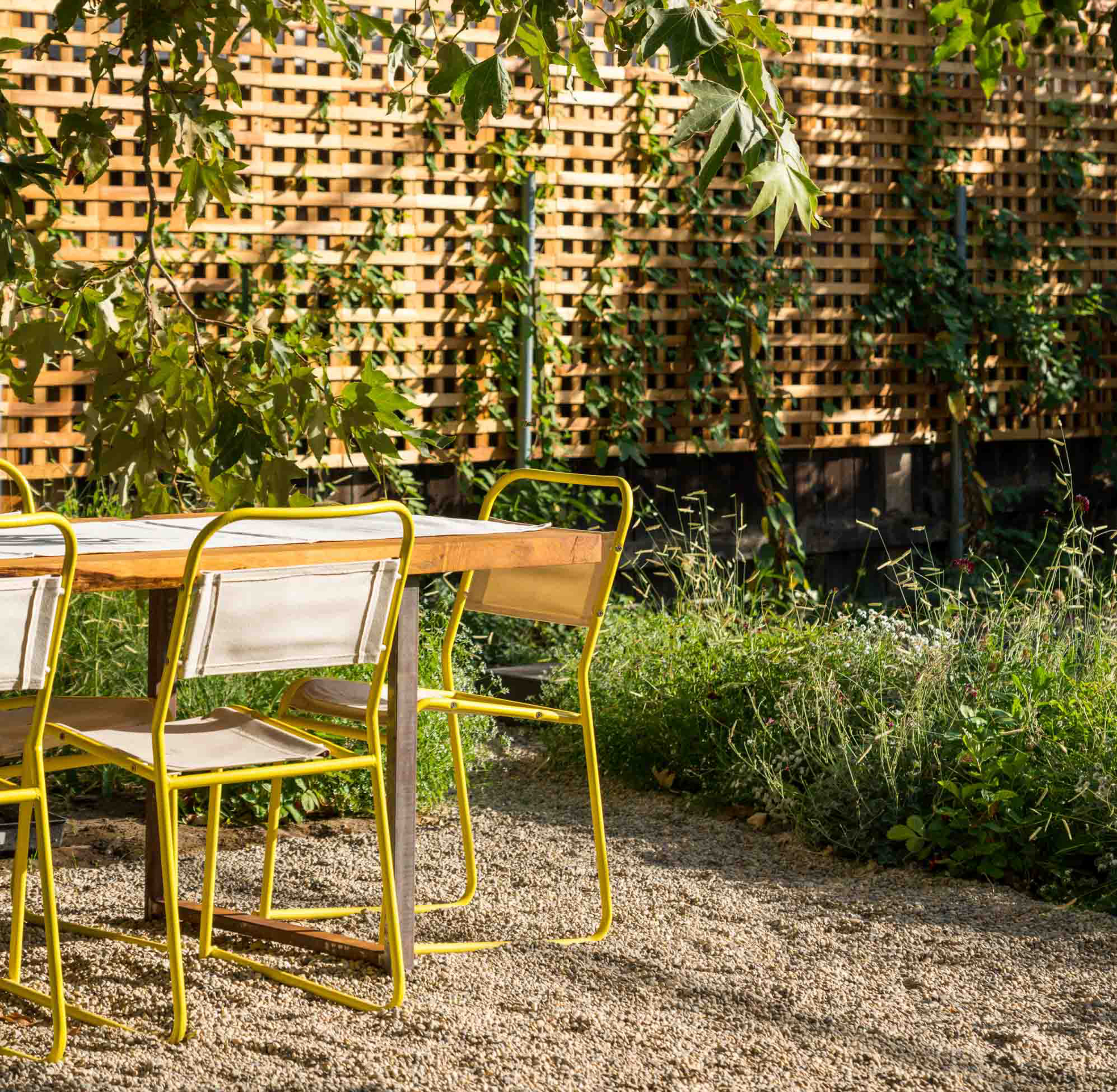 outdoor table with yellow metal chairs