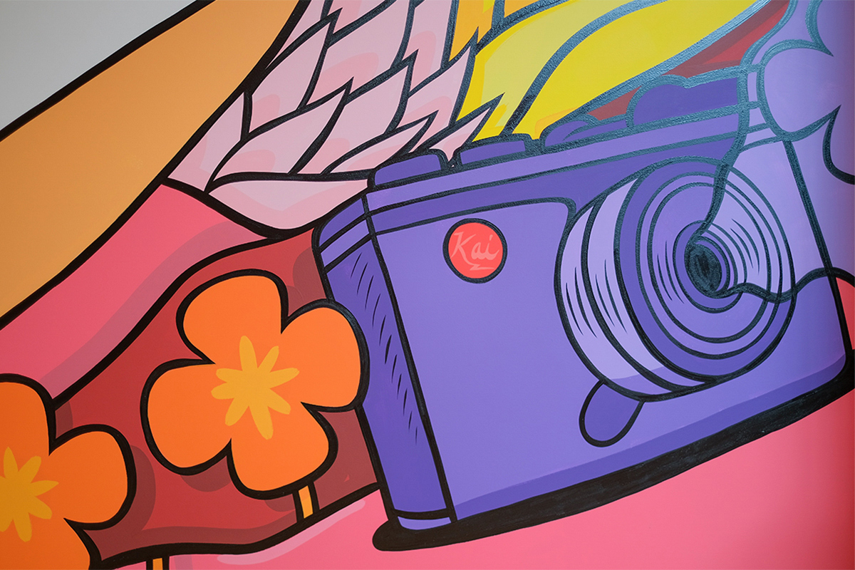 close up shot of a purple camera on a colorful mural