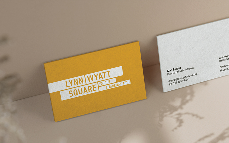 The front and back of business cards for Lynn Wyatt Square