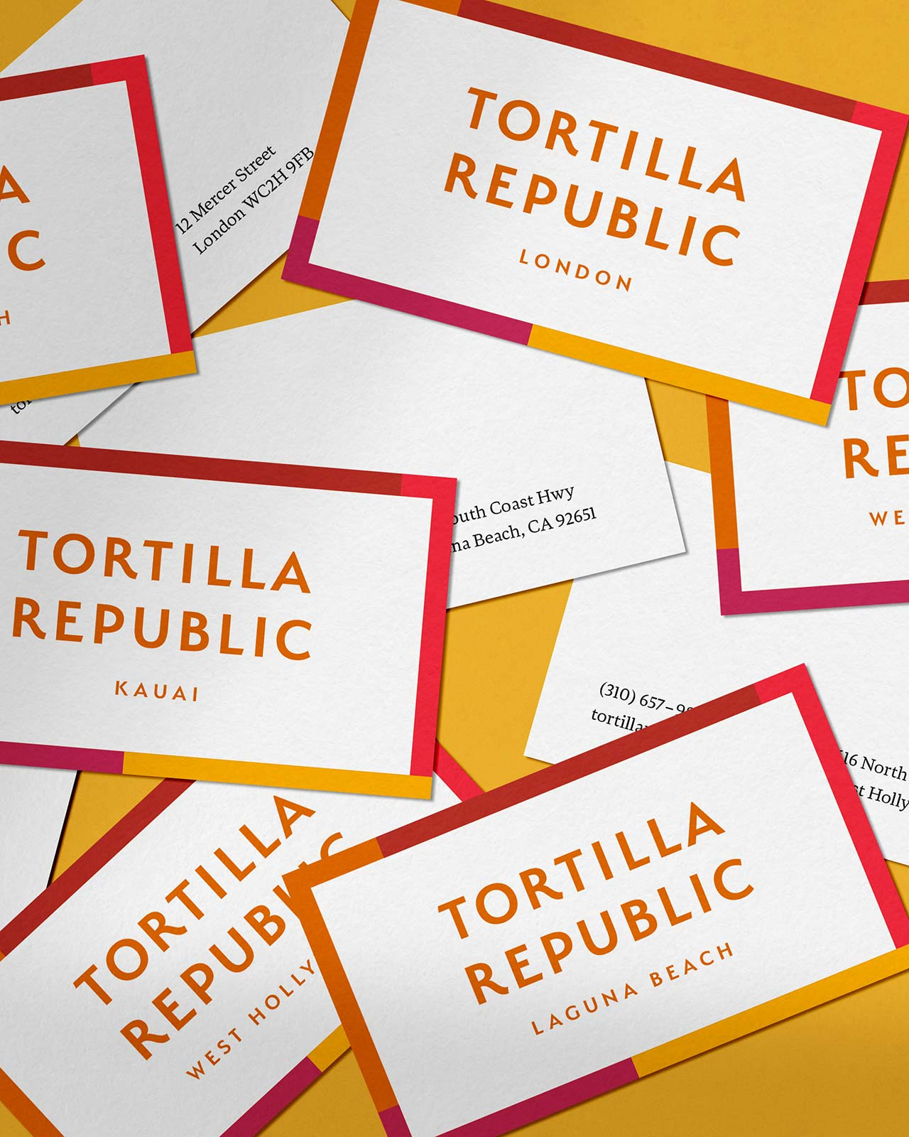 Tortilla Republic business cards with colored border scattered on yellow background