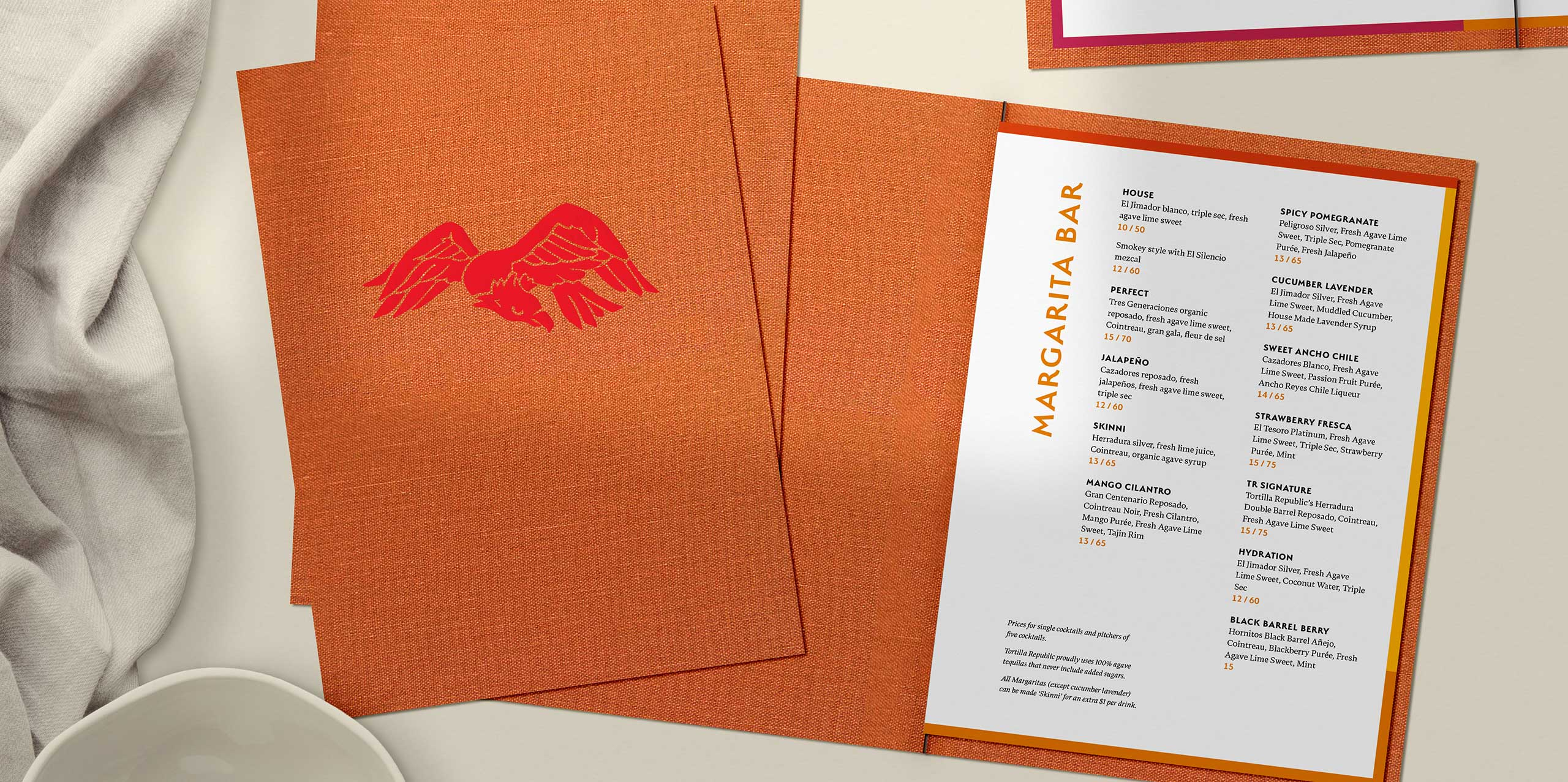 Tortilla Republic cocktail menu orange cover with eagle illustration