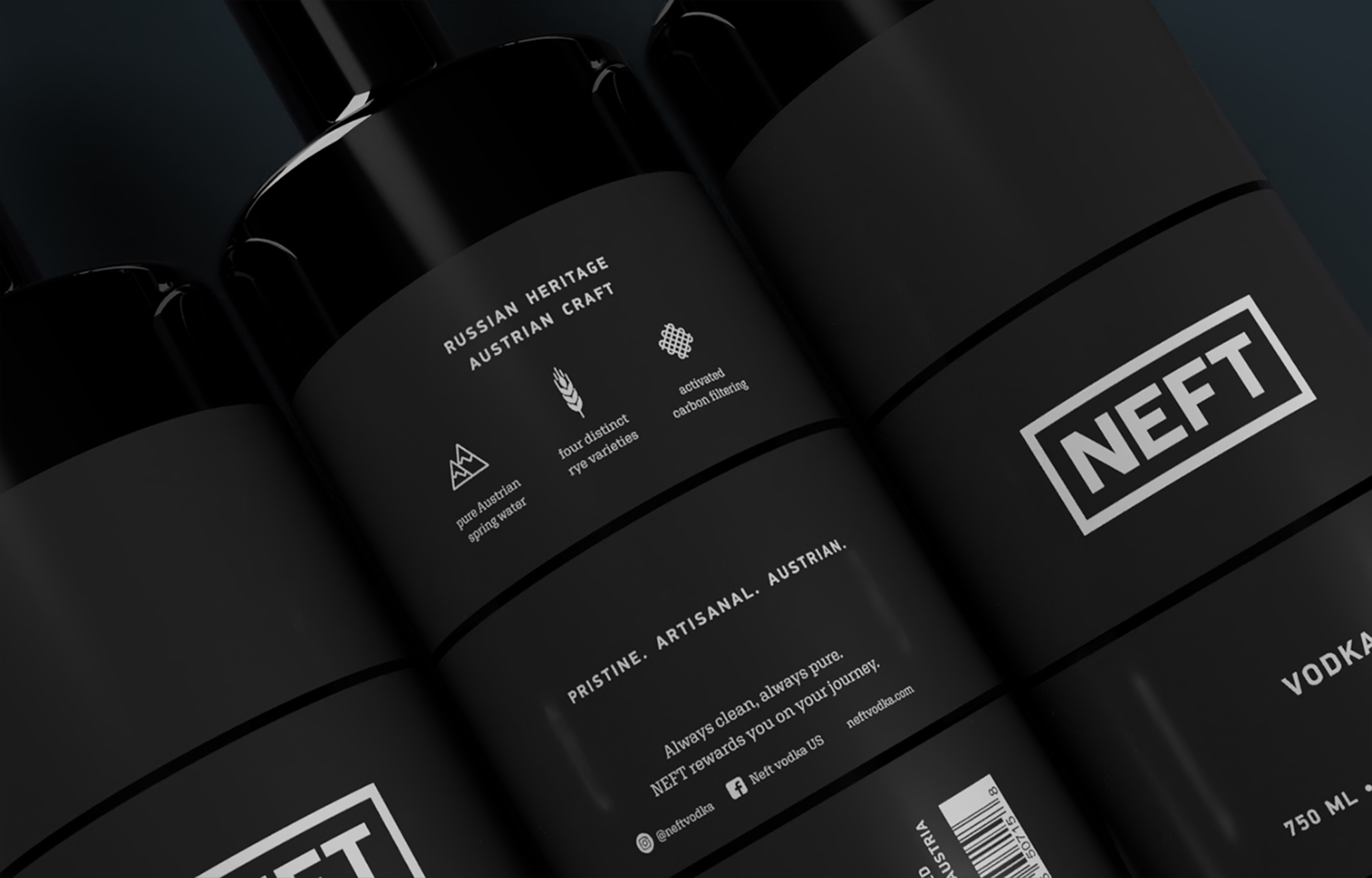 Detailed view of the typography design on the Vodka NEFT bottles