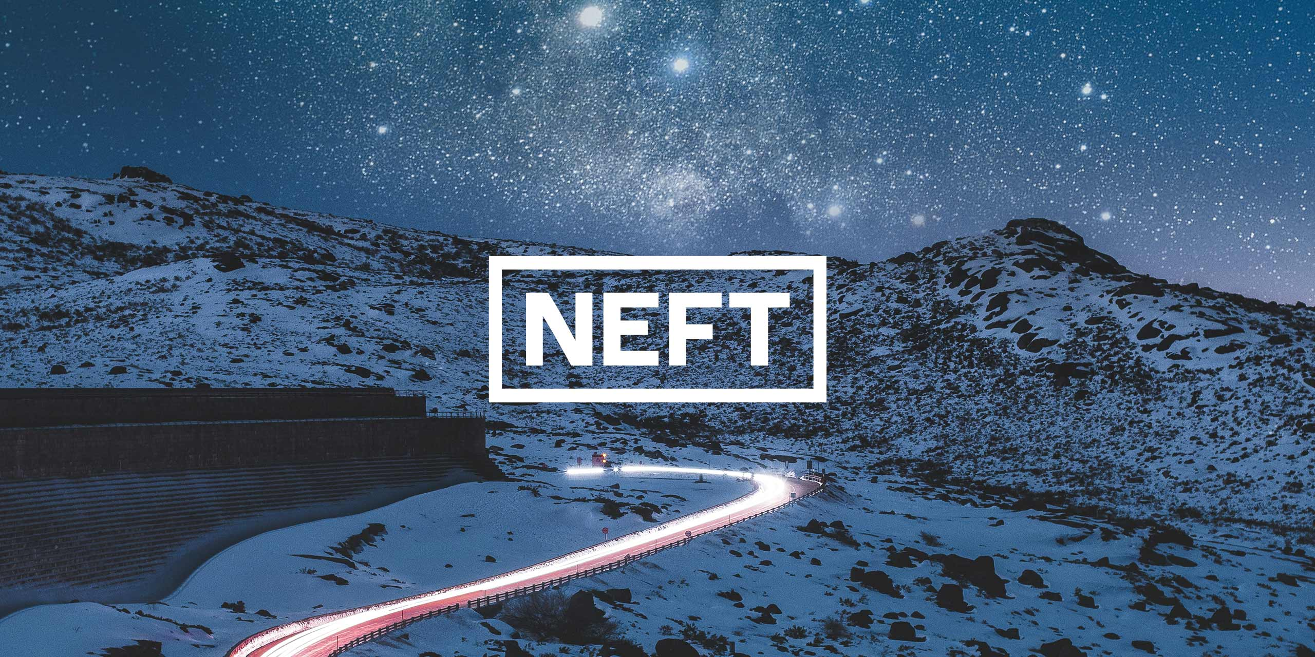 The white NEFT logo center over an image of a road at nighttime under the stars