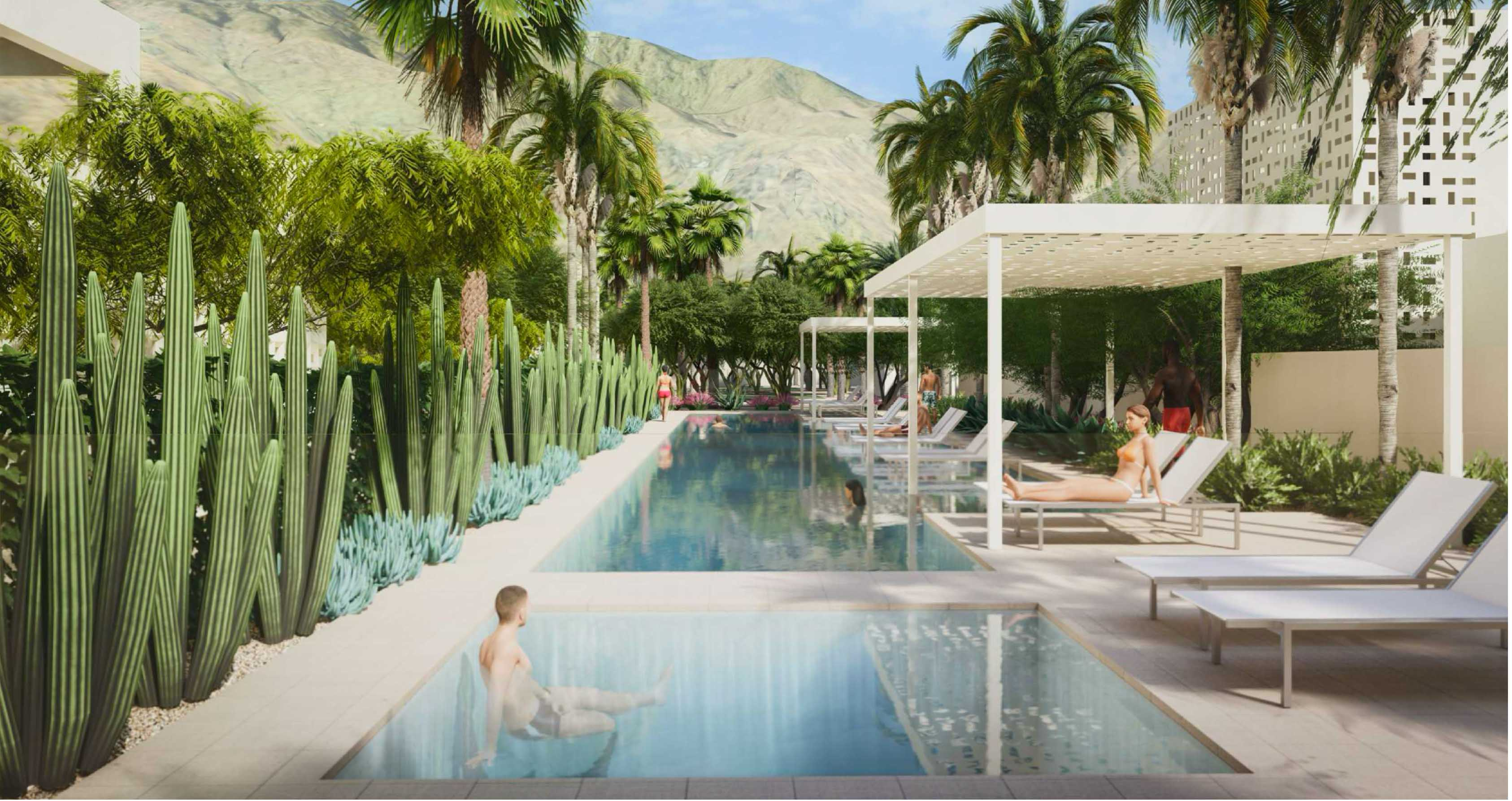 People lounging by the pool surrounded by nature with a view of the mountains